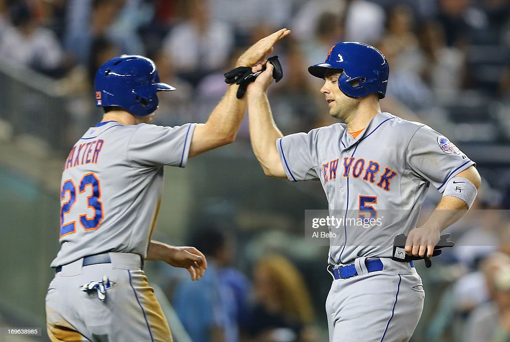 Mike Baxter #23, and <a gi-track='captionPersonalityLinkClicked' href=/galleries/search?phrase=David+Wright+-+Baseball+Player&family=editorial&specificpeople=209172 ng-click='$event.stopPropagation()'>David Wright</a> #5 of the New York Mets celebrate scoring against the New York Yankees in the fourth inning during their game on May 29, 2013 at Yankee Stadium in the Bronx borough of New York City