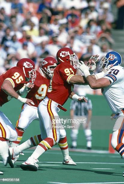 Mike Bell of the Kansas City Chiefs rushes up against Dave Studdard of the Denver Broncos during an NFL football game October 27 1985 at Arrowhead...