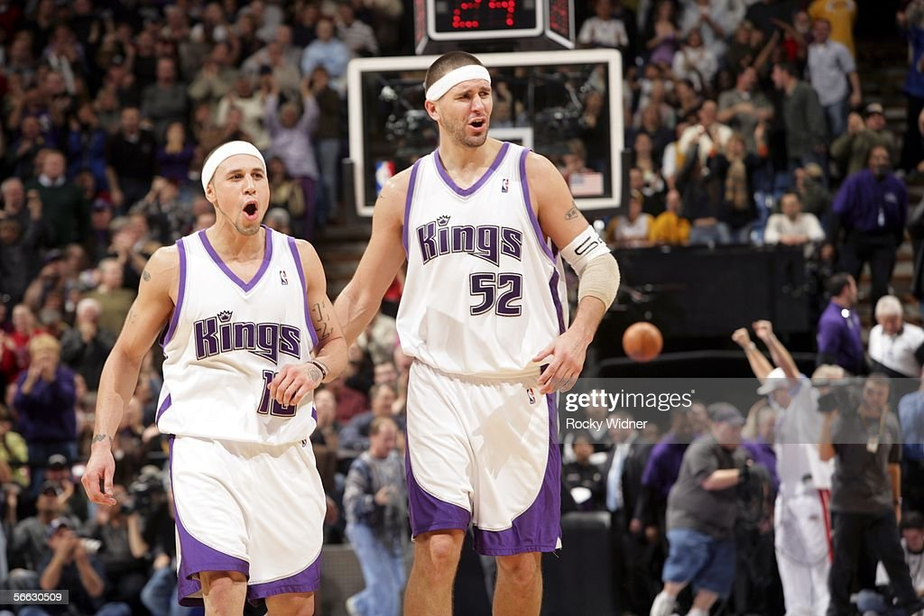 Mike Bibby and Brad Miller of the Sacramento Kings celebrate in overtime against the Los Angeles Lakers on January 19 2006 at the ARCO Arena in...