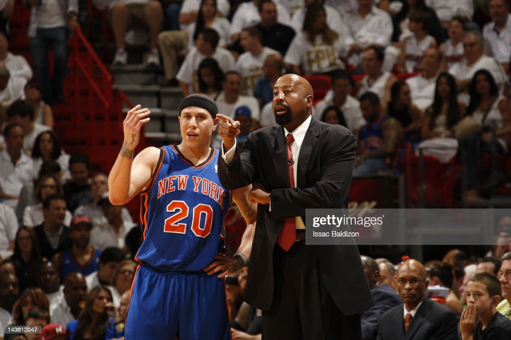 Mike Bibby #20 and Mike Woodson, Head Coach of the New York Knicks disscuss a play during the game against the Miami Heat in Game One of the Eastern Conference Quarterfinals during the 2012 NBA Playoffs on April 28, 2012 at American Airlines Arena in Miami, Florida.