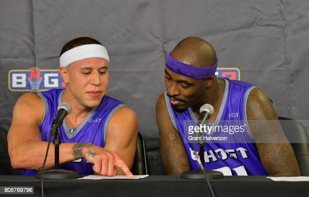 Mike Bibby and Ricky Davis of Ghost Ballers look over the stat sheet during a press conference during week two of the BIG3 three on three basketball...