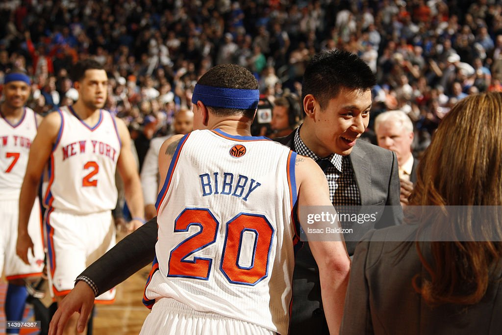 Mike Bibby #20 is congratulated by teammate Jeremy Lin #17 of the New York Knicks after defeating the Miami Heat in Game Four of the Eastern Conference Quarterfinals during the 2012 NBA Playoffs on May 6, 2012 at Madison Square Garden in New York City, New York.