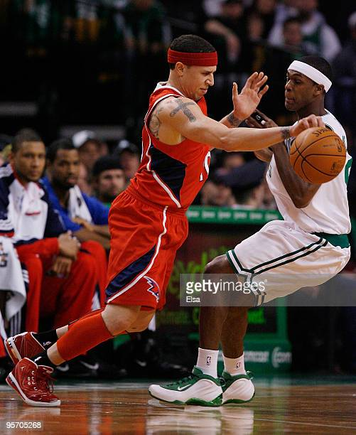 Mike Bibby of the Atlanta Hawks tries to get around Rajon Rondo of the Boston Celtics at the TD Garden on January 11 2010 in Boston Massachusetts...
