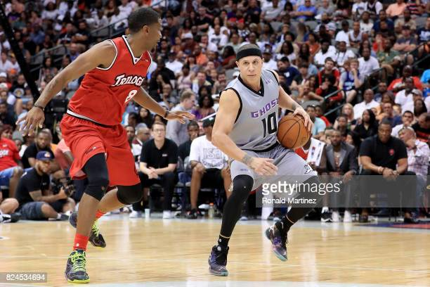 Mike Bibby of the Ghost Ballers dribbles the ball while being guarded by James White of Trilogy during week six of the BIG3 three on three basketball...