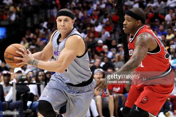 Mike Bibby of the Ghost Ballers dribbles the ball while being guarded by Rashad McCants of Trilogy during week six of the BIG3 three on three...