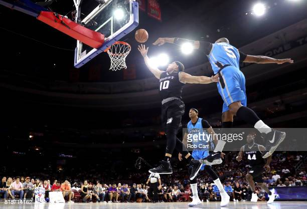 Mike Bibby of the Ghost Ballers drives to the basket against Cuttino Mobley of Power during week four of the BIG3 three on three basketball league at...