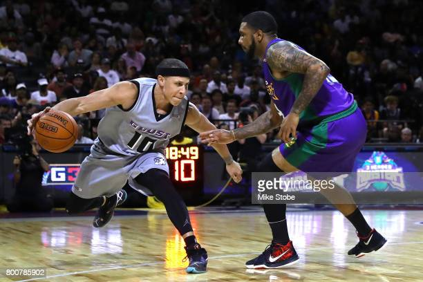 Mike Bibby of the Ghost Ballers handles the ball against Eddie Basden of the 3 Headed Mosters during week one of the BIG3 three on three basketball...