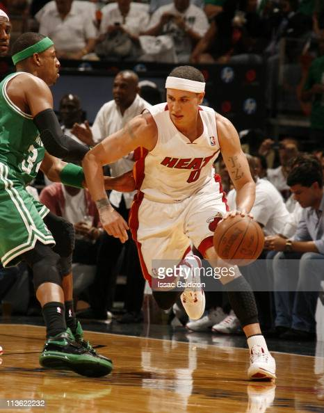 Mike Bibby of the Miami Heat handles the ball against Paul Pierce of the Boston Celtics in Game Two of the Eastern Conference Semifinals during the...