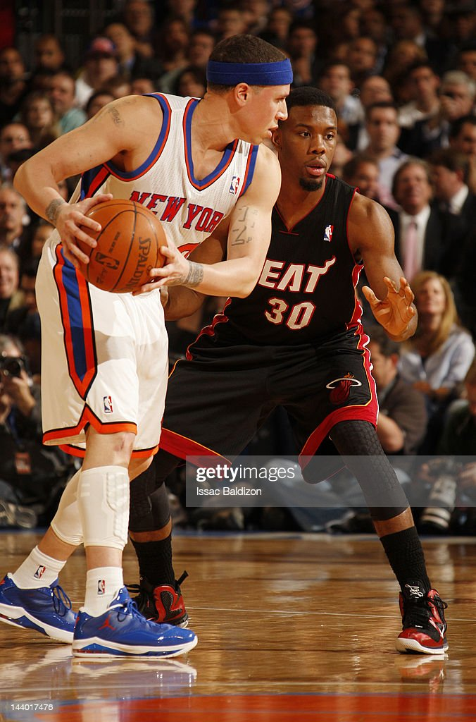 Mike Bibby #20 of the New York Knicks controls the ball against Norris Cole #30 of the Miami Heat in Game Three of the Eastern Conference Quarterfinals during the 2012 NBA Playoffs on May 3, 2012 at Madison Square Garden in New York City, New York.