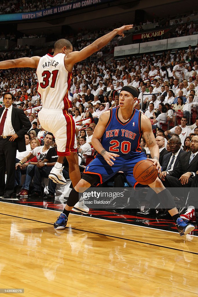 Mike Bibby #20 of the New York Knicks fakes a a shot attempt against Shane Battier #31 of the Miami Heat in Game One of the Eastern Conference Quarterfinals during the 2012 NBA Playoffs on April 28, 2012 at American Airlines Arena in Miami, Florida.