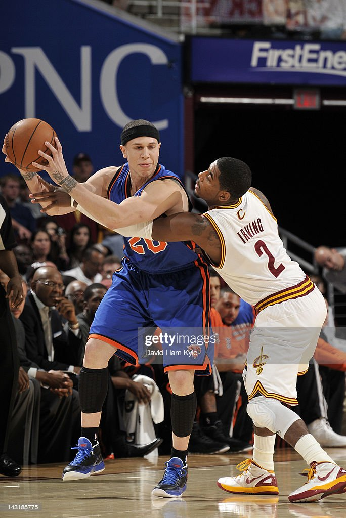 Mike Bibby #20 of the New York Knicks holds the ball just out of reach of Kyrie Irving #2 of the Cleveland Cavaliers at The Quicken Loans Arena on April 20, 2012 in Cleveland, Ohio.