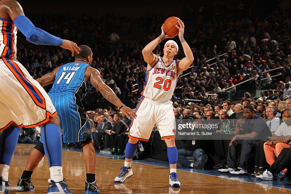 Mike Bibby #20 of the New York Knicks looks to pass the ball against the Orlando Magic on March 28, 2012 at Madison Square Garden in New York City.