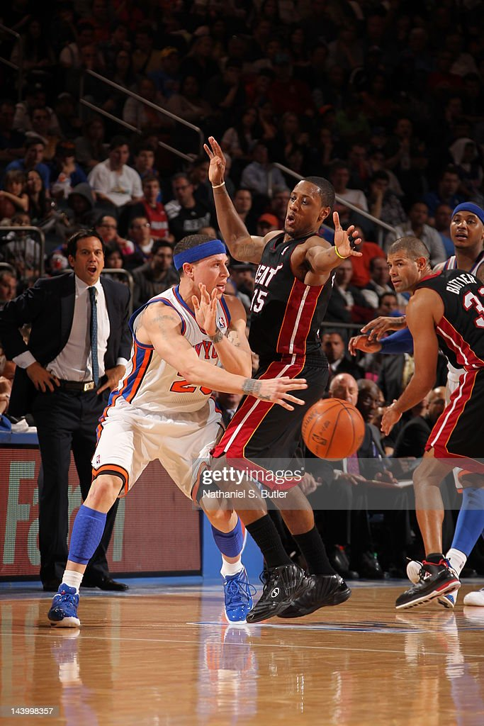 Mike Bibby #20 of the New York Knicks passes the ball against Mario Chalmers #15 of the Miami Heat in Game Four of the Eastern Conference Quarterfinals during the 2012 NBA Playoffs on May 6, 2012 at Madison Square Garden in New York City.