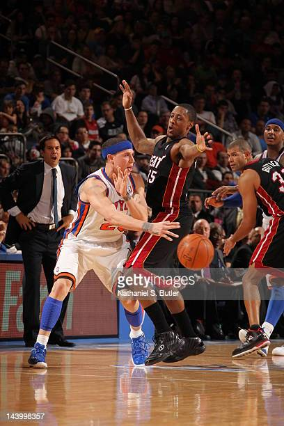 Mike Bibby of the New York Knicks passes the ball against Mario Chalmers of the Miami Heat in Game Four of the Eastern Conference Quarterfinals...