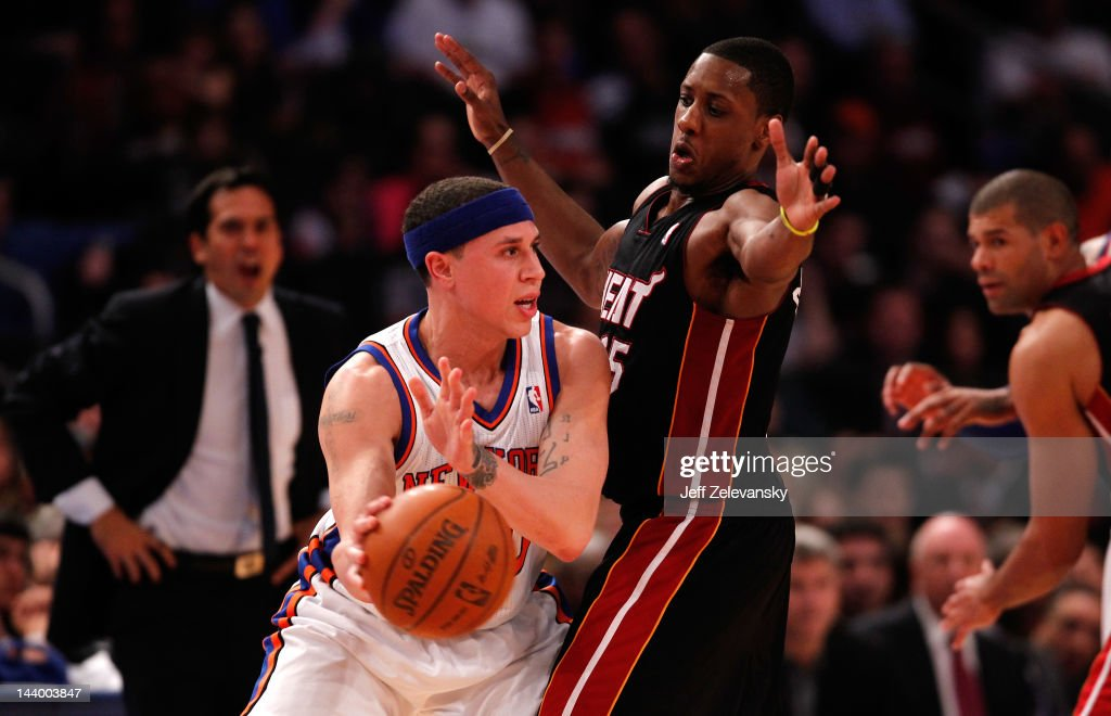 Mike Bibby #20 of the New York Knicks passes the ball against Mario Chalmers #15 of the Miami Heat in Game Four of the Eastern Conference Quarterfinals in the 2012 NBA Playoffs on May 6, 2012 at Madison Square Garden in New York City.