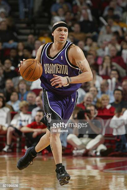 Mike Bibby of the Sacramento Kings drives against Houston Rockets during the game on January 28 2005 at the Toyota Center in Houston Texas The Kings...