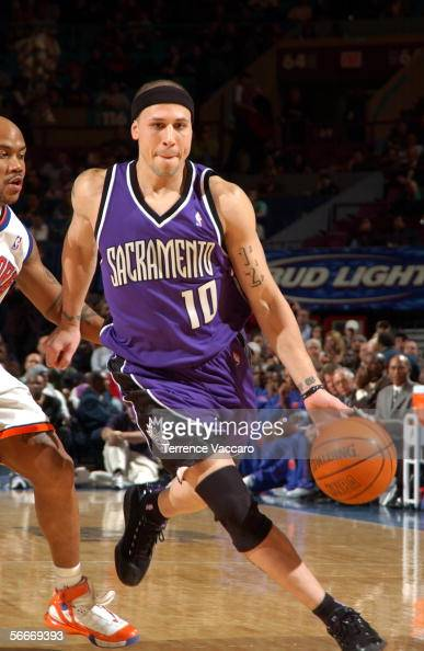 Mike Bibby of the Sacramento Kings drives against Stephon Marbury of the New York Knicks on January 25 2006 at Madison Square Garden in New York City...