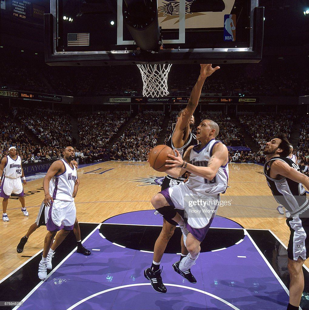 Mike Bibby of the Sacramento Kings goes for the layup against Tim Duncan of the San Antonio Spurs in game four of the Western Conference...