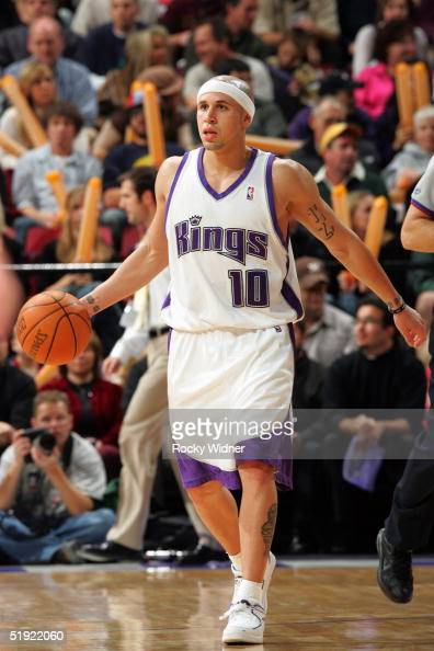 Mike Bibby of the Sacramento Kings moves the ball against the Washington Wizards at Arco Arena on December 21 2004 in Sacramento California The Kings...