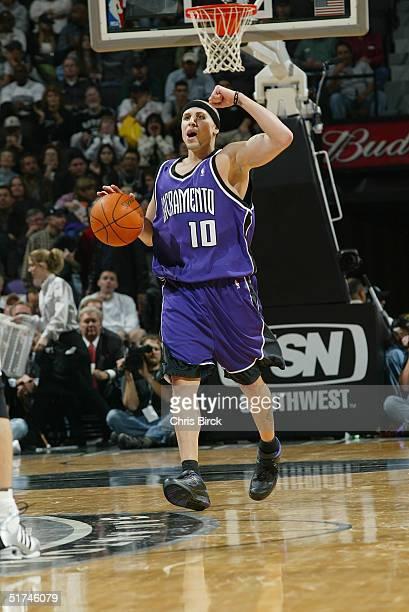 Mike Bibby of the Sacramento Kings moves the ball against the San Antonio Spurs during the game at the SBC Center on November 3 2004 in San Antonio...