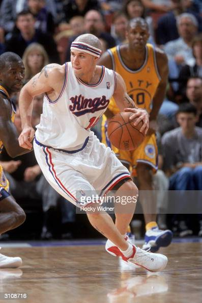 Mike Bibby of the Sacramento Kings moves the ball during the game against the Golden State Warriors at Arco Arena on March 9 2004 in Sacramento...