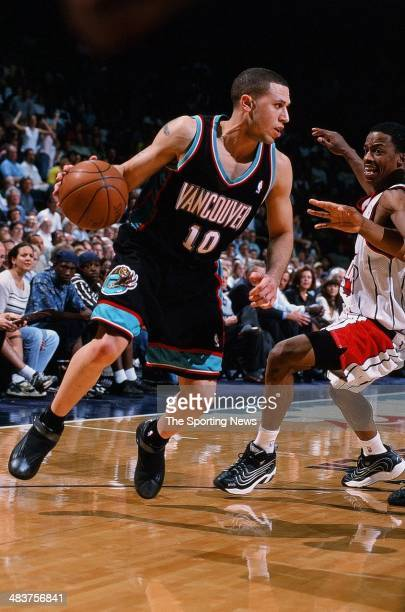 Mike Bibby of the Vancouver Grizzlies moves the ball during the game against the Houston Rockets on April 19 2000 at the Compaq Center in Houston...