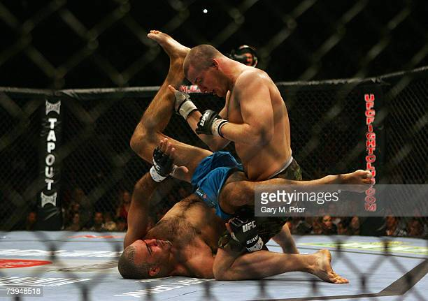Mike Bisping of England and Elvis Sinosic of Australia in action during a Light Heavyweight bout of the Ultimate Fighting Championship at the...