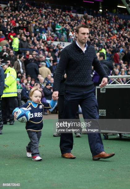 Mike Blair Scotland with his son and the matchball