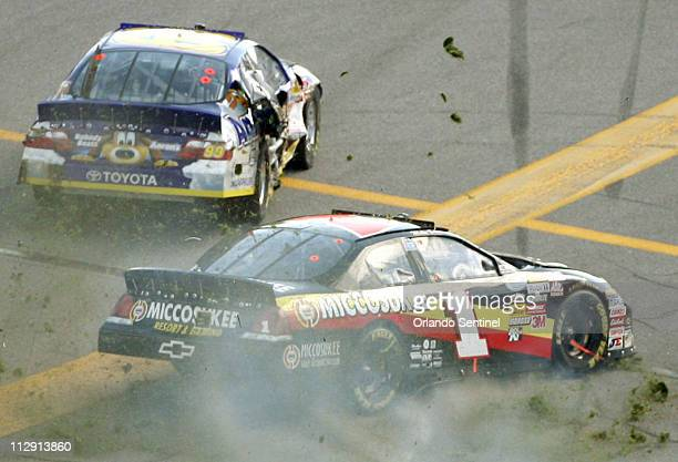 Mike Bliss collides with Michael Waltrip left during the Camping World 300 race at Daytona International Speedway in Daytona Beach Florida Saturday...