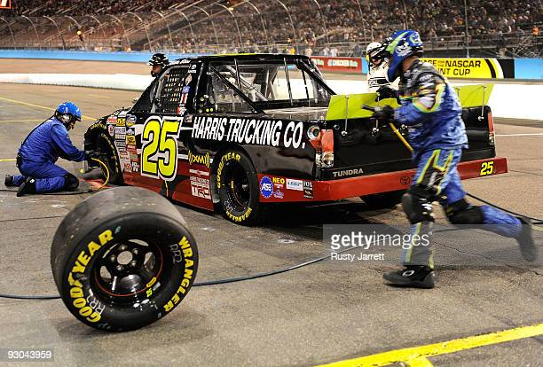 Mike Bliss driver of the Harris Trucking Toyota comes in for a pit stop during the NASCAR Camping World Truck Series Lucas Oil 150 at Phoenix...