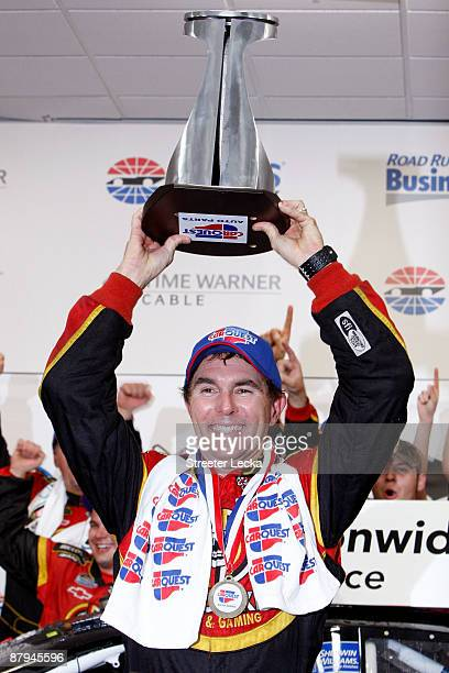 Mike Bliss driver of the Miccosukee Indian Gaming Resort Chevrolet celebrates in victory lane after winning the NASCAR Nationwide Series CARQUEST...
