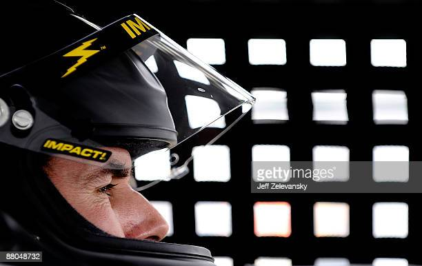 Mike Bliss driver of the Phoenix Racing Dodge sits in his car during practice for the NASCAR Sprint Cup Series Autism Speaks 400 at Dover...