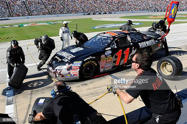 Mike Bliss driver of the Ridemakerz Toyota pits during the NASCAR Nationwide Series O'Reilly Challenge at Texas Motor Speedway on November 7 2009 in...