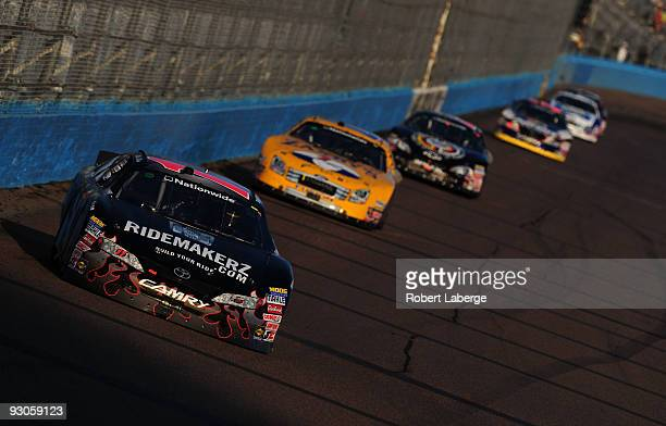Mike Bliss driver of the Ridemarkerzcom Toyota leads a pack of cars during the NASCAR Nationwide Series Able Body Labor 200 at Phoenix International...