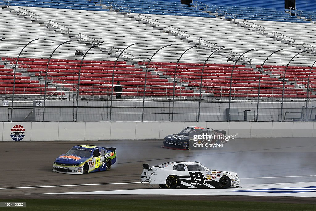 Mike Bliss, driver of the #19 Tristar Motorsports/Plaza Hotel & Casino Ford, and Scott Lagasse Jr., driver of the #8 HybridLight/Boy Scouts of America Chevrolet, are involved in an incident during practice for the NASCAR Nationwide Series Sam's Town 300 at Las Vegas Motor Speedway on March 9, 2013 in Las Vegas, Nevada.