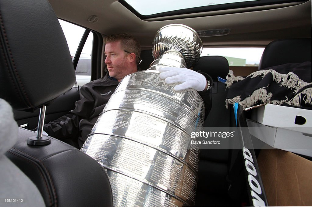 Mike Bolt of the Hockey Hall of Fame leaves from the Fun Fair at the Stirling and District Recreation Centre with the Stanley Cup during Kraft Hockeyville Day 1 on September 30, 2012 in Stirling, Ontario, Canada.