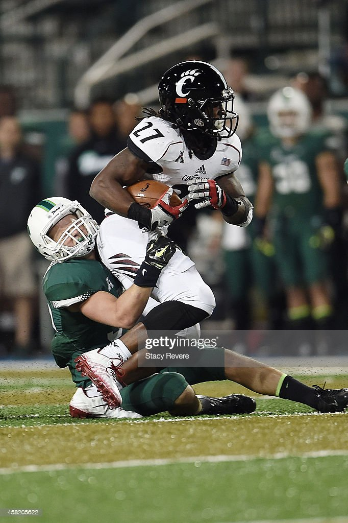 Mike Boone #27 of the Cincinnati Bearcats is brought down by Sam Scofield #35 of the Tulane Green Wave during the fourth quarter of a game at Yulman Stadium on October 31, 2014 in New Orleans, Louisiana.