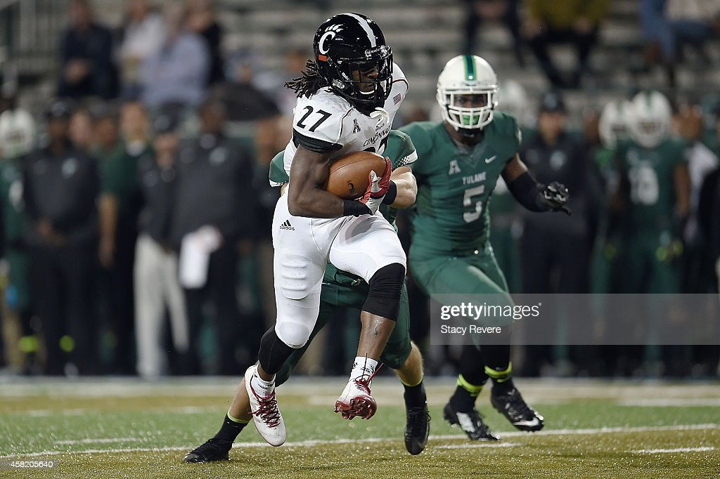 Mike Boone #27 of the Cincinnati Bearcats runs for yards against the Tulane Green Wave during the fourth quarter of a game at Yulman Stadium on October 31, 2014 in New Orleans, Louisiana.