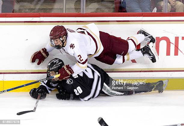 Mike Booth of the Boston College Eagles dives over Kasper Bjorkqvist of the Providence College Friars during NCAA hockey at Kelley Rink on October 28...