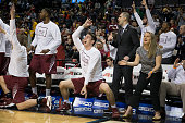 Mike Booth of the Saint Joseph's Hawks reacts from the bench against the Virginia Commonwealth Rams in the championship game of the men's Atlantic 10...