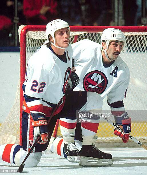 Mike Bossy and Bryan Trottier of the New York Islanders take a break during a game at the Nassau Coliseum in Uniondale New York