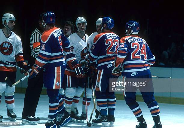Mike Bossy of the New York Islanders argues with Glenn Anderson Charlie Huddy and Kevin McClelland of the Edmonton Oilers during the 1984 Stanley Cup...