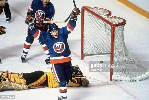 Mike Bossy of the New York Islanders celebrates a goal against goaltender Richard Brodeur of the Vancouver Canucks en route to winning the 1982...