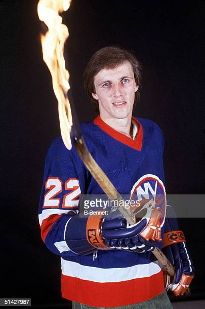 Mike Bossy of the New York Islanders holds a blazing hockey stick as he poses for a portrait in October of 1980 Mike Bossy played for the Islanders...