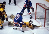 Mike Bossy of the New York Islanders scores the game winning goal as his teammate Bryan Trottier makes sure it's in as goalie Richard Brodeur of the...