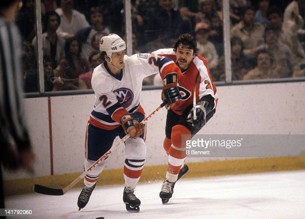 Mike Bossy of the New York Islanders skates with the puck as Bob Dailey of the Philadelphia Flyers tries to defend during the 1980 Stanley Cup Finals...