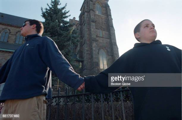 Mike Boudreau and his brother Chris Boudreau of Newton along with hundreds of protesters form a human chain around The Cathedral Of The Holy Cross...