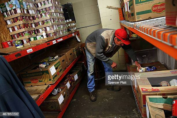 Mike Brecka shelves food at a food pantry operated by Gonzales Christian Assistance Ministry one of the few social services organizations in Gonzales...
