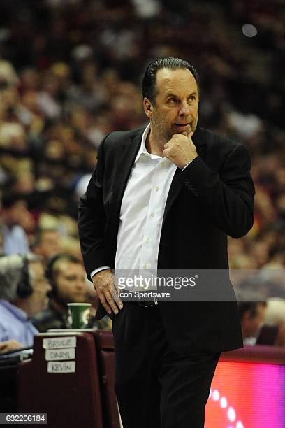 Mike Brey head coach Notre Dame Fighting Irish thumbs his chin on the sideline in an Atlantic Coast Conference matchup against the Florida State...