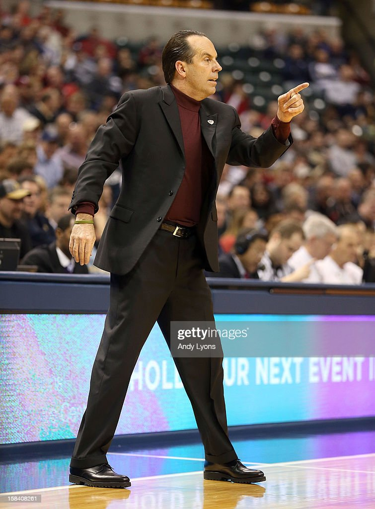 <a gi-track='captionPersonalityLinkClicked' href=/galleries/search?phrase=Mike+Brey&family=editorial&specificpeople=221188 ng-click='$event.stopPropagation()'>Mike Brey</a> the head coach of the Notre Dame Fighting Irish gives instructions to his team during the game against the Purdue Boilermakers during Boston Scientific Close The Gap Crossroads Classic at Bankers Life Fieldhouse on December 15, 2012 in Indianapolis, Indiana.